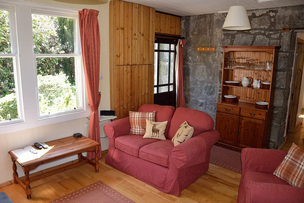 Living room with views to cottage garden and loch