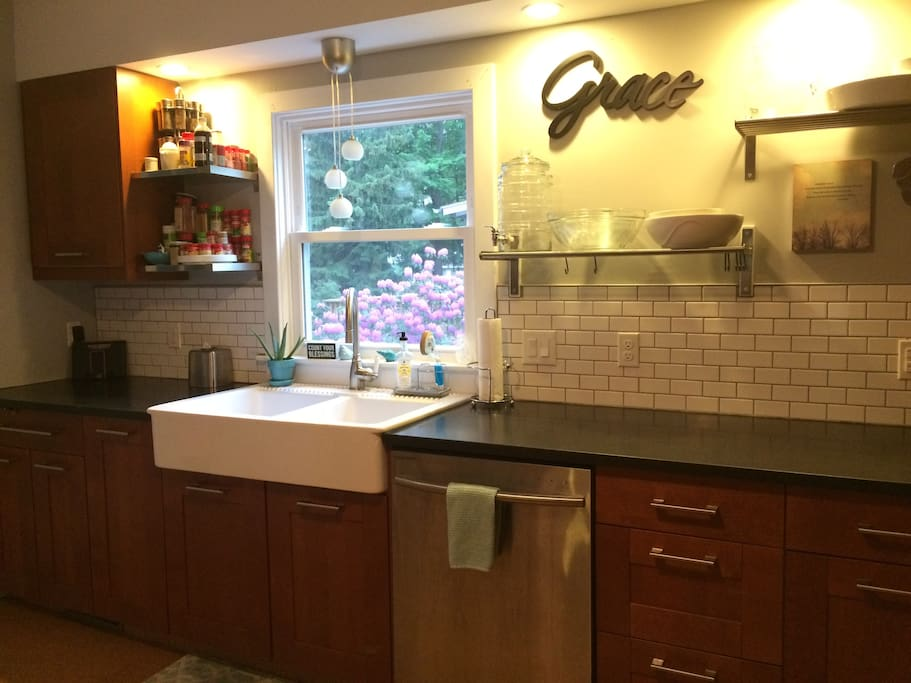 updated kitchen with new appliances, farmhouse sink, & granite countertops