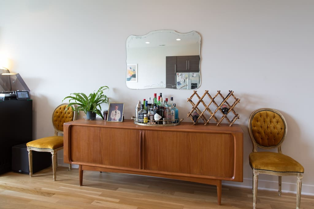 Mid-century credenza flanking the kitchen/living room area.