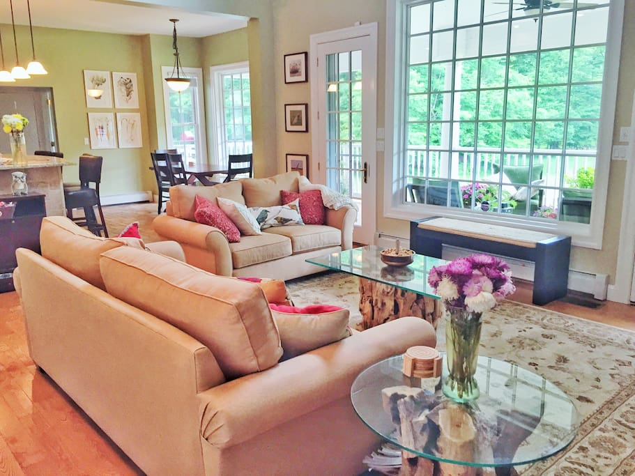 Family room with two large, very comfy couches, as well as a bench.  Family room overlooks the porch, pond, and surrounding forest.