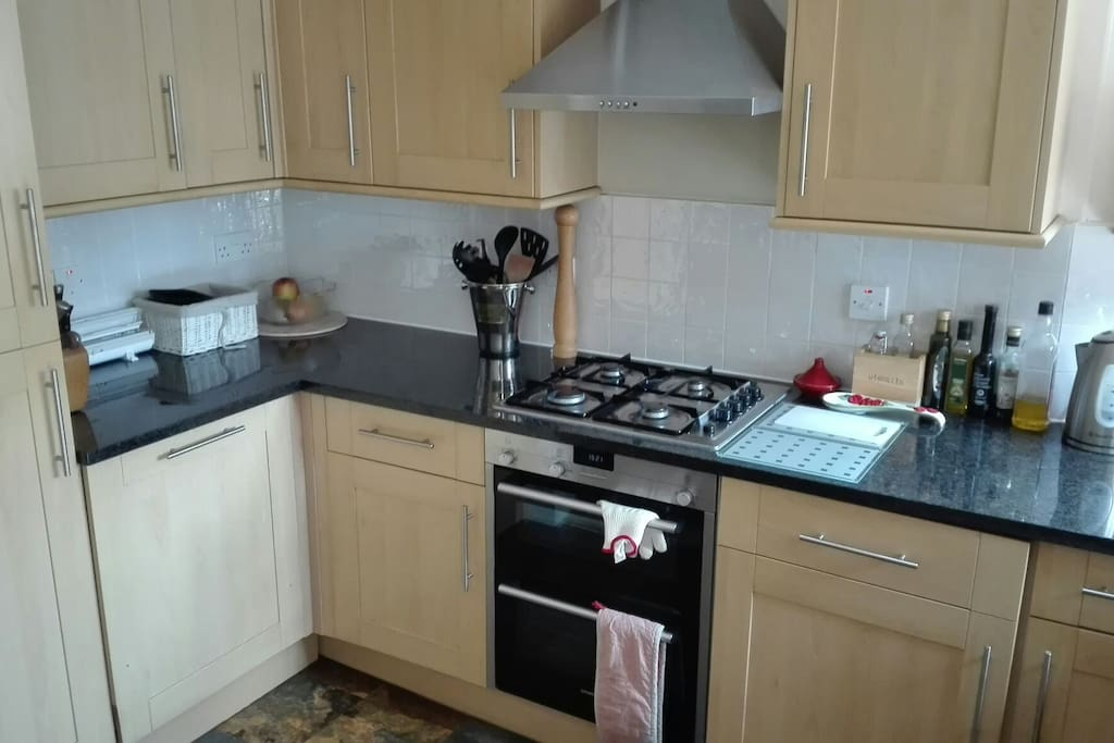 Modern kitchen with fan-assisted oven, hob and dishwasher