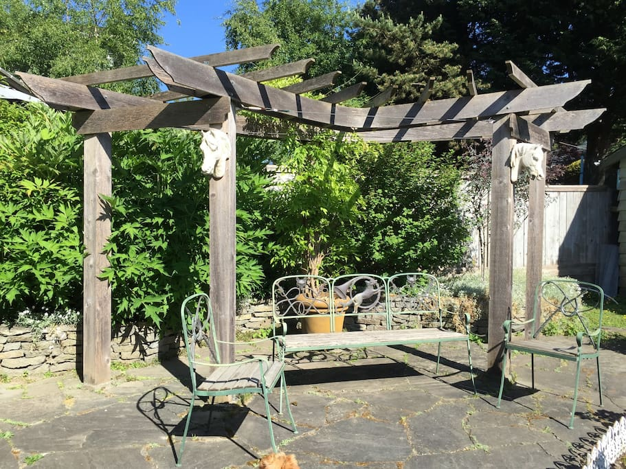 Garden vista of Pergola with Irish horse heads