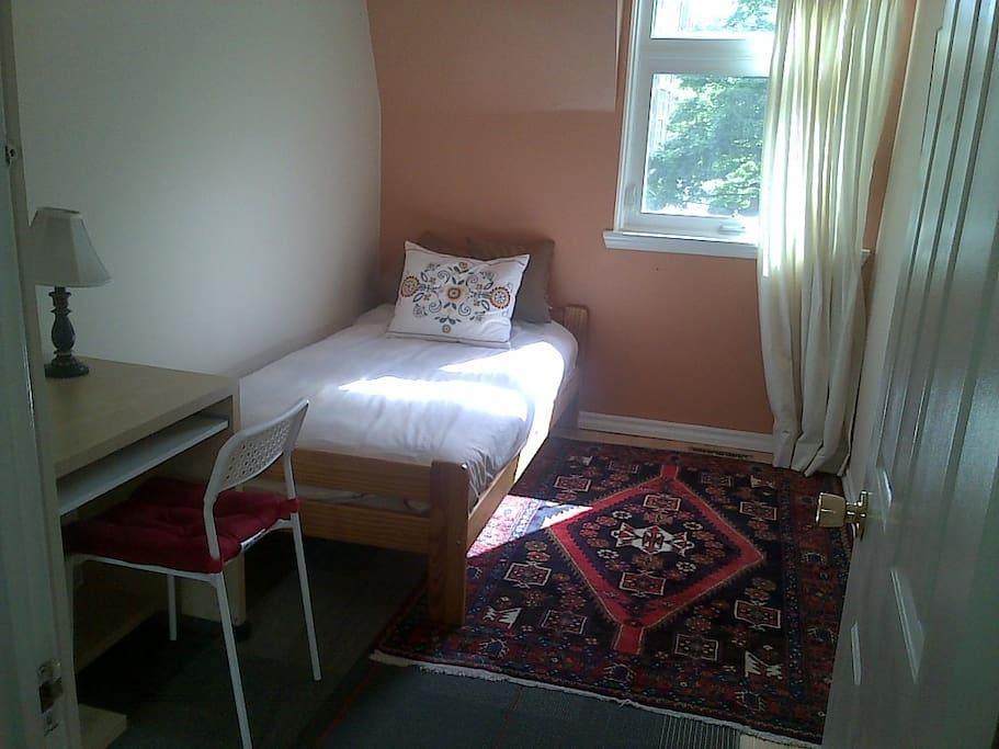 Here is the cozy bedroom.
