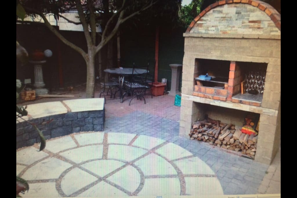Outdoor BBQ (braai) area with courtyard and outdoor eating Al-Fresco