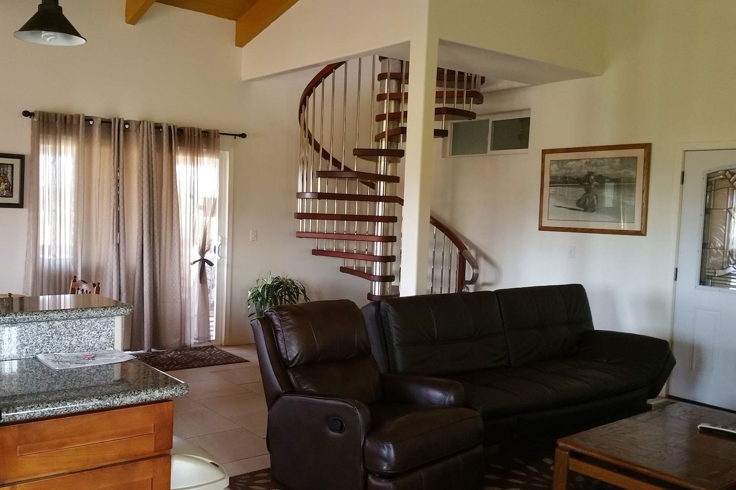Spacious living room in the Nice, Big House w/ spiral staircase