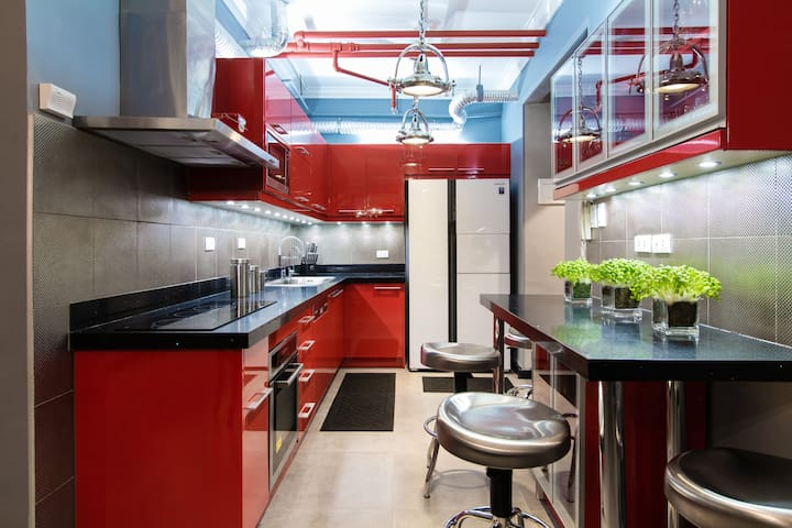 Full gourmet kitchen with convection oven/broiler, dishwasher, in-sink garbage disposal, and separate fresh drinking water faucet.