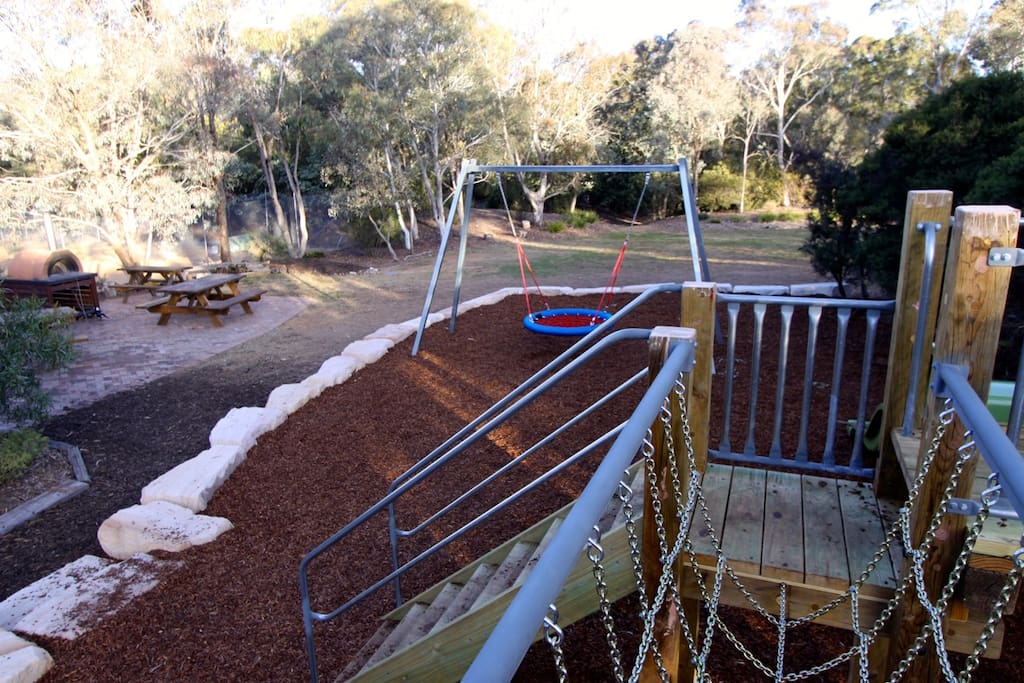 The 'Big Playground' has a birds nest swing, slide and climbing frame. Near pizza oven.