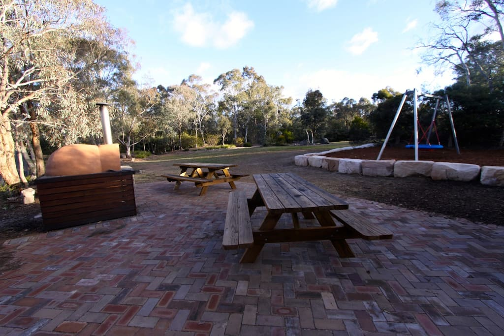 Pizza oven, looking from near BBQ. A large picnic shelter (not shown) makes this a great spot to dine out in any weather.