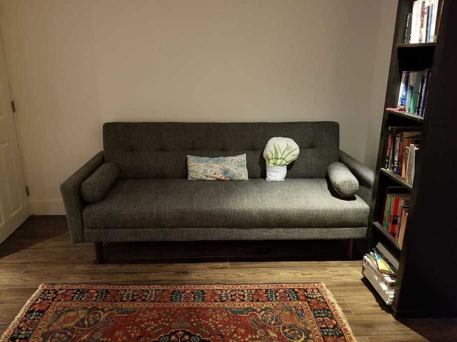 Lovely living space, including a pull-out Crate and Barrell Sofa.