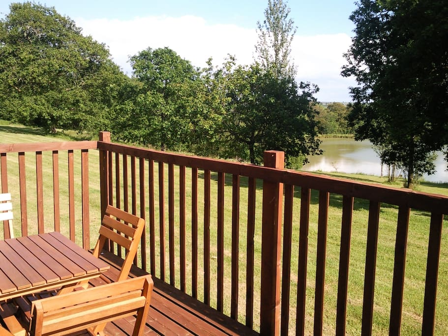 The private, South-facing terrace has lovely views across the lake to the Devon countryside beyond