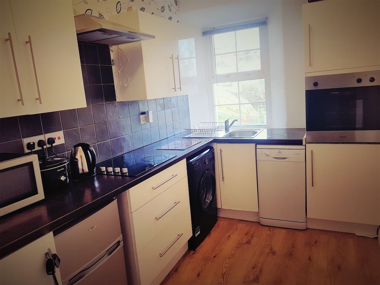 The fully fitted kitchen offers everything you need from a toastie maker to oven and hob, washing machine and fridge freezer.