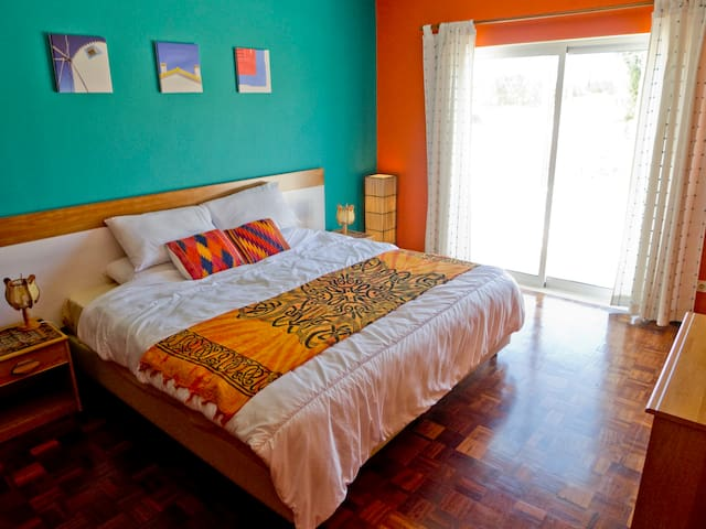 Large double (or twin) bedroom with sunset facing balconey