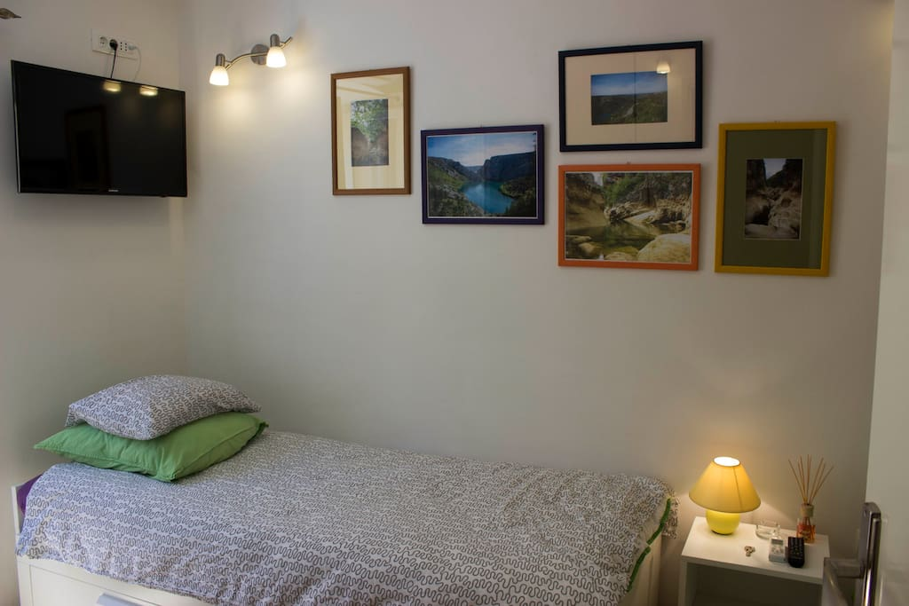 Double bed. Pictures on the wall of our beutiful region.