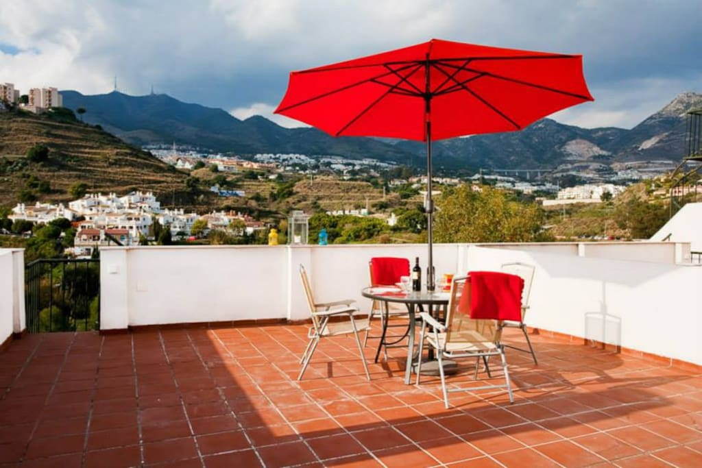 Roof terras( Atico) with village and mountain view.
