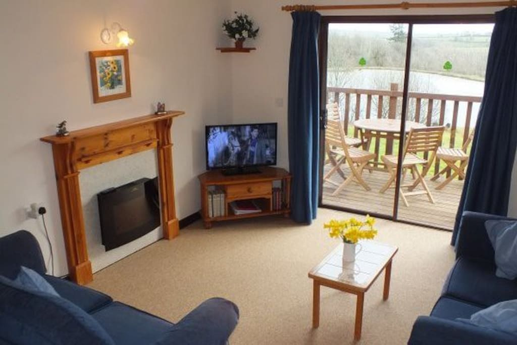 The open plan living area has an HDTV with built in DVD/CD and wide patio doors giving access to the private terrace