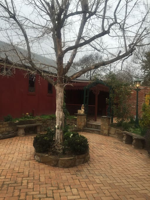 Globe features beautiful courtyard Relax with a cup of Selvis coffee or Indian tea Beautiful in spring time with lots of climbing roses
