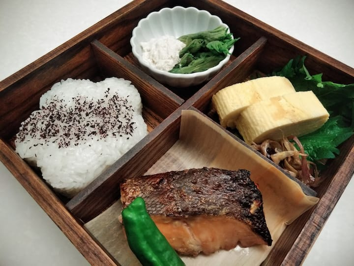 Bento box with grilled salmon