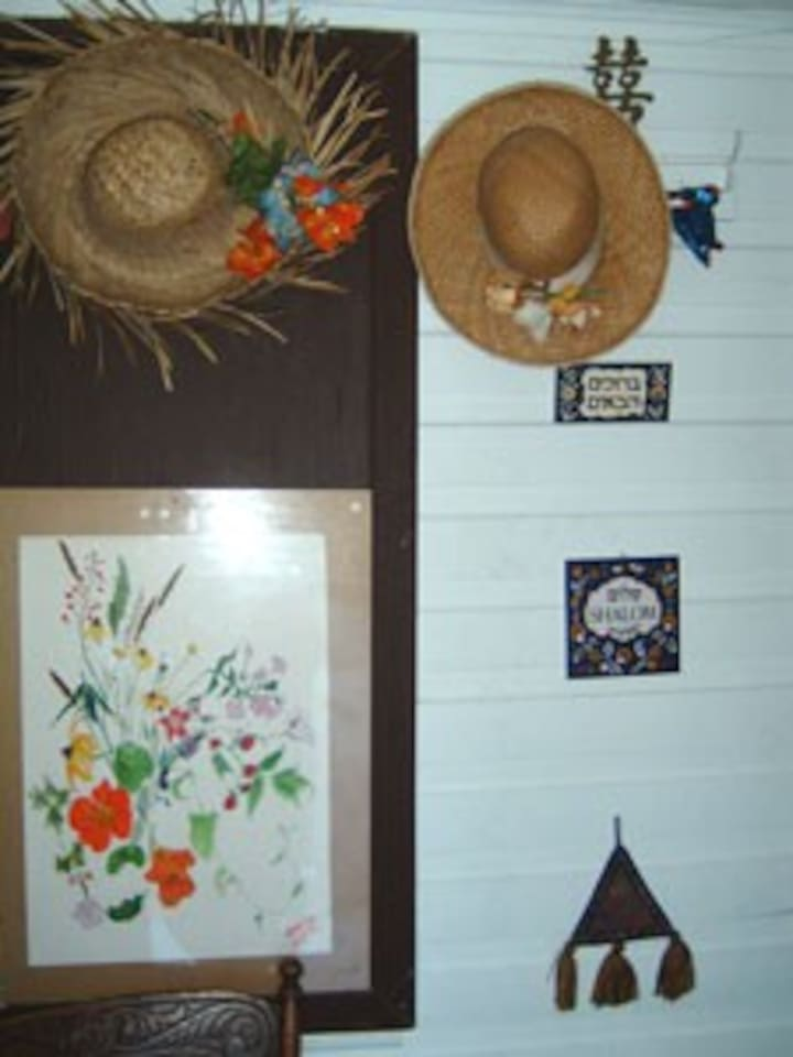 The entrance/vestibule  saying welcome/Shalom and has one of my old garden flowers painting.