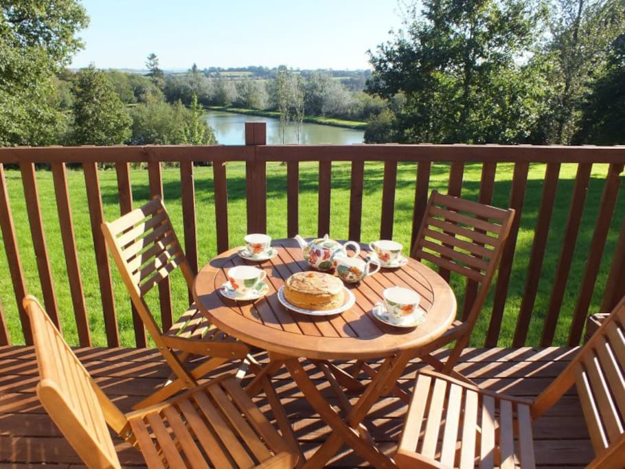 Kestrel Lodge has a private, South-facing terrace overlooking the lake and rolling Devon countryside beyond