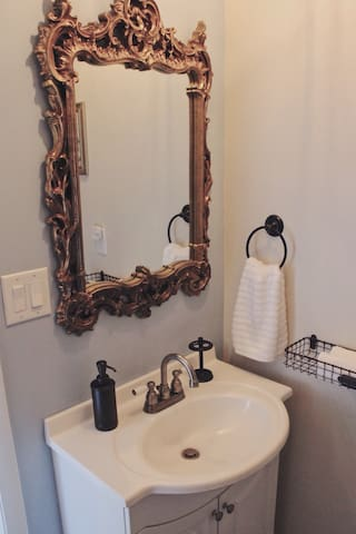 This elegant oversized mirror is perfect for multiple people to get ready.