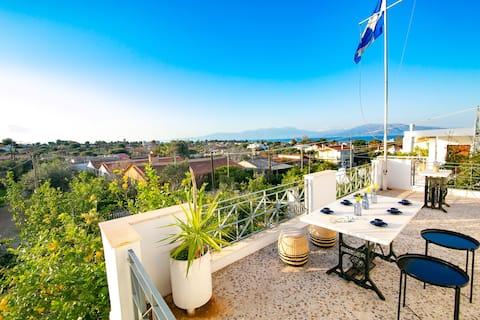 Kalamos sea view villa. Beach walking distance.