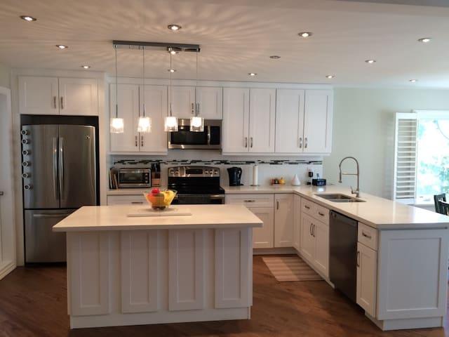 Brand new modern and light kitchen.