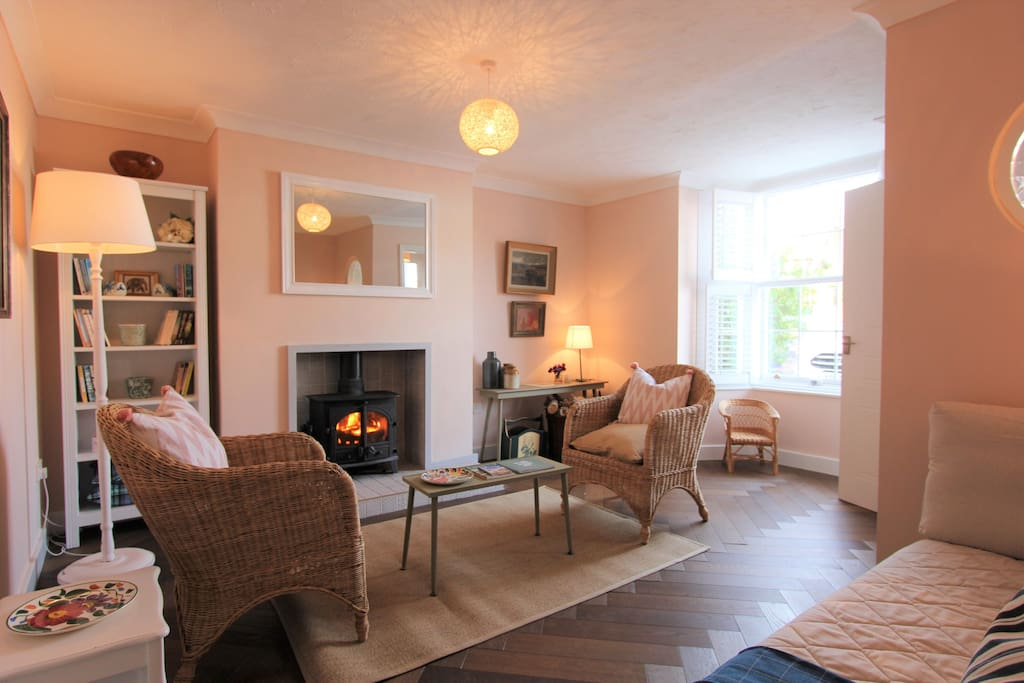 Cosy living room with wood burning stove.