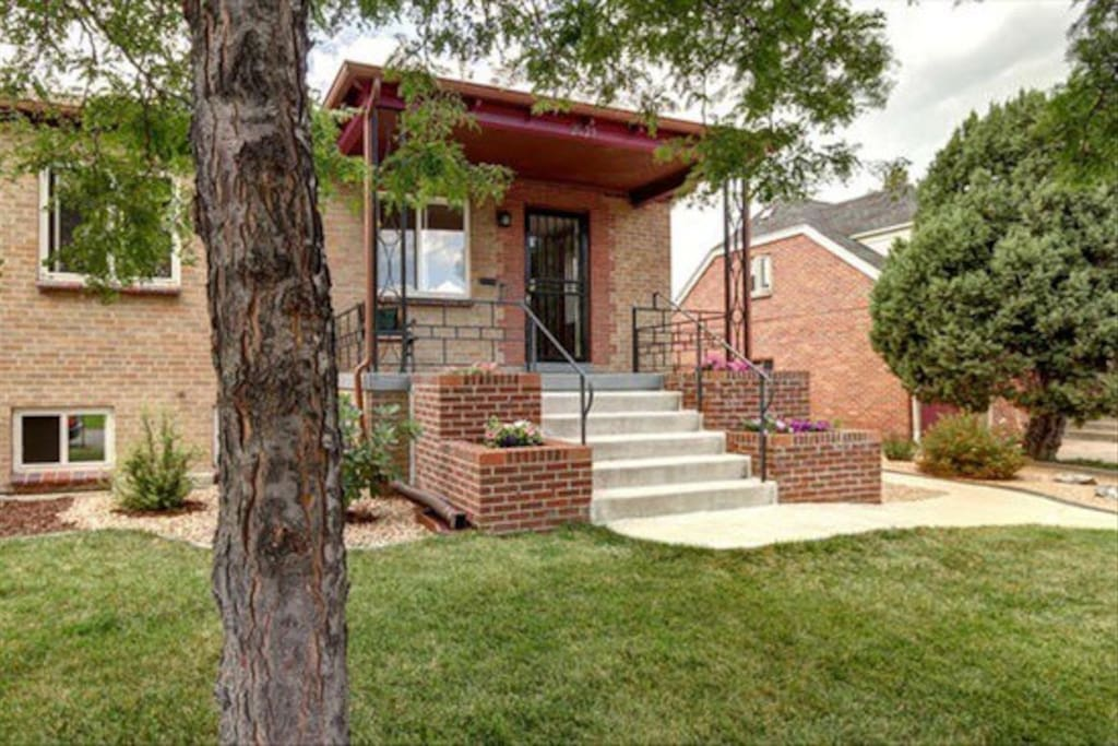 Charming 1940's brick front porch (though guest access is through back porch)