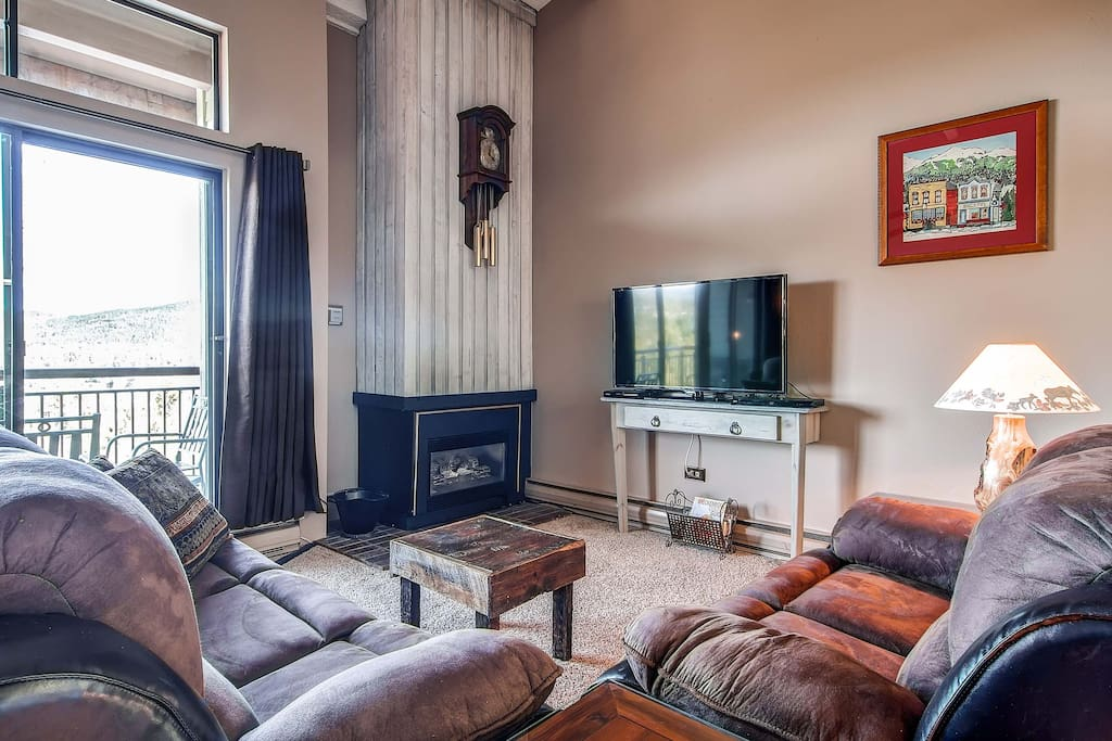 Melt off the ice from the ski hill in front of this fireplace after a long day of skiing