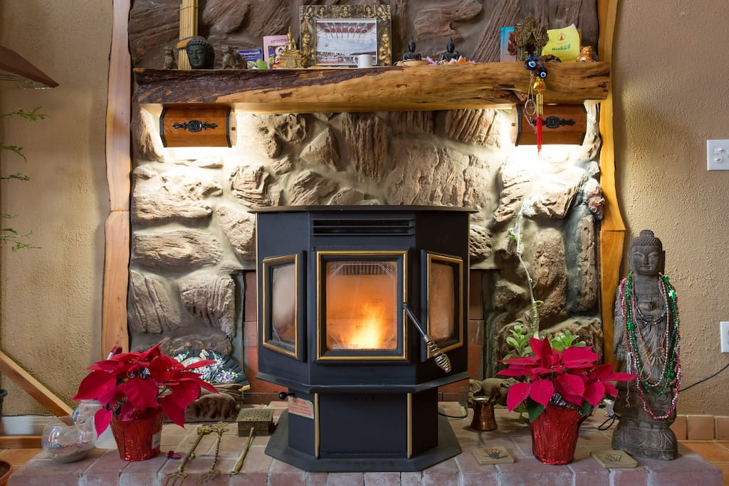 Pellet stove fire in your living room with Buddha