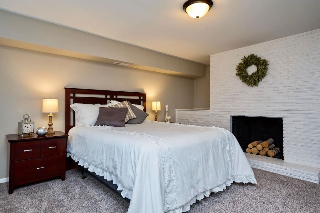 Spacious & inviting master bedroom, complete with fireplace