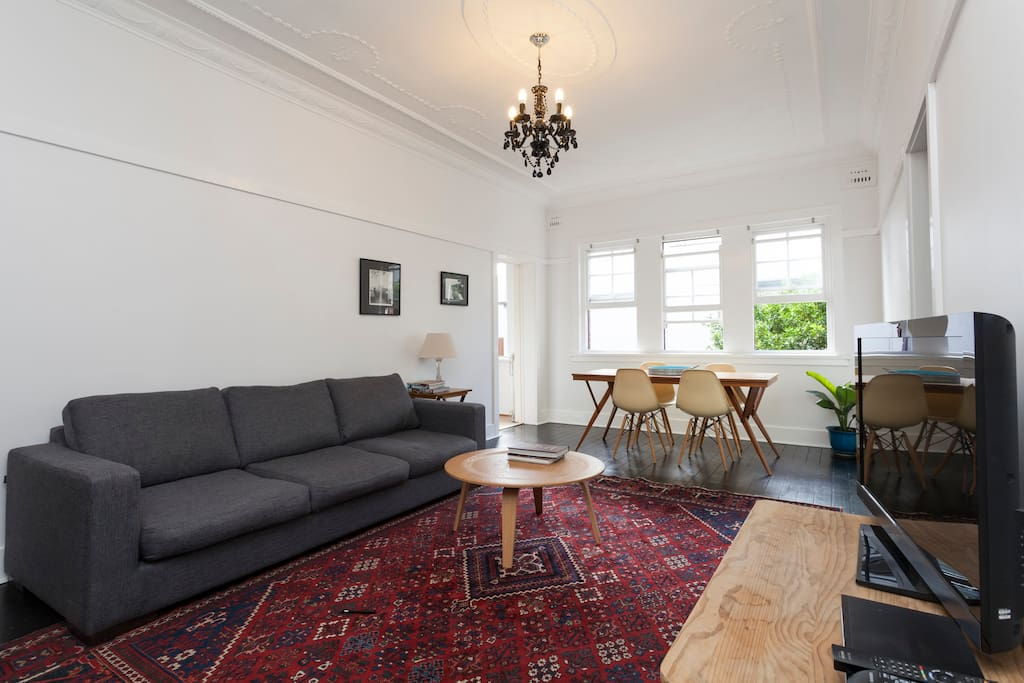Very light and open plan Living/Dining area with 3 seater couch, 6 seater dining table.