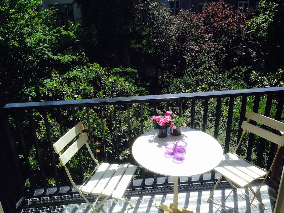 Sunny breakfasts and lunches at the backside balcony