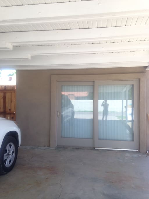 This is the covered parking spot you may use and the double doors go into the private unit.