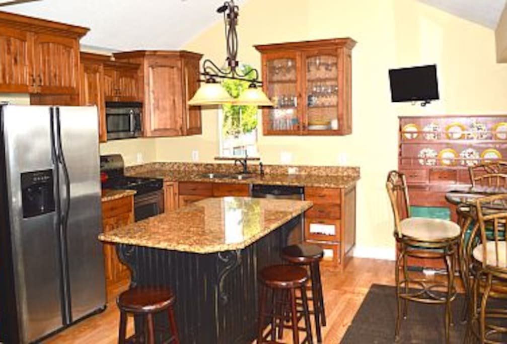 Elegant Spacious Kitchen with Granite Countertops and stainless steel appliances