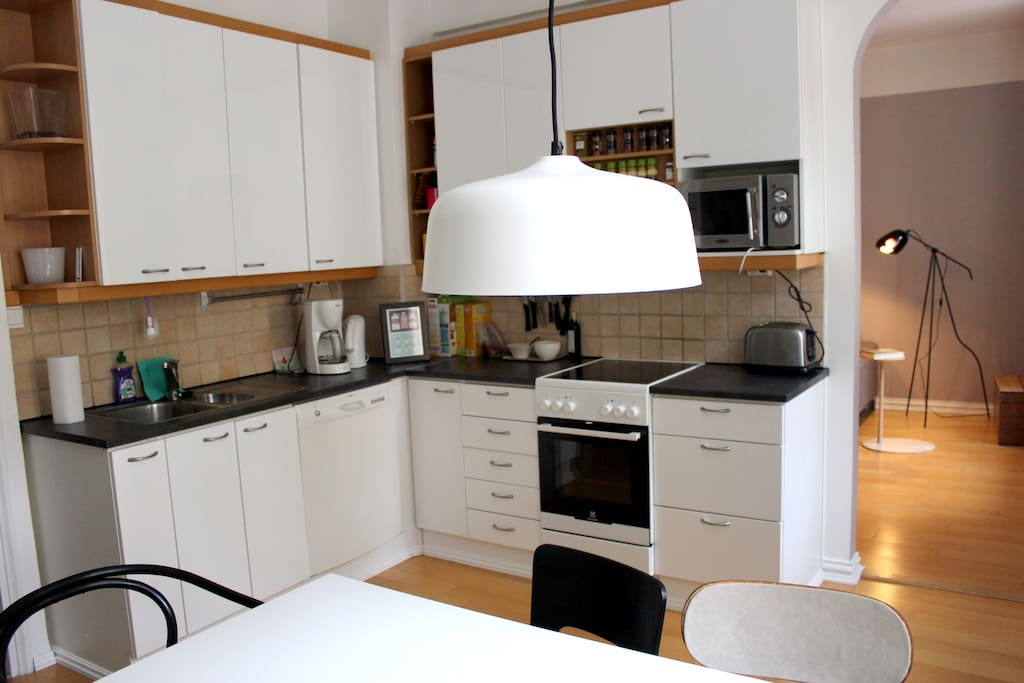 Kitchen has a stove, oven, dish washer, toaster, coffee machine, microwave, fridge, freezer and is furnished with all necessary plates, bowls, glasses, utensils, pots and pans.