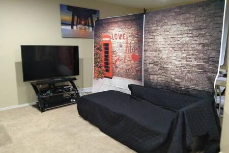 "50"" HDTV, mini-fridge, microwave, ceiling fan"