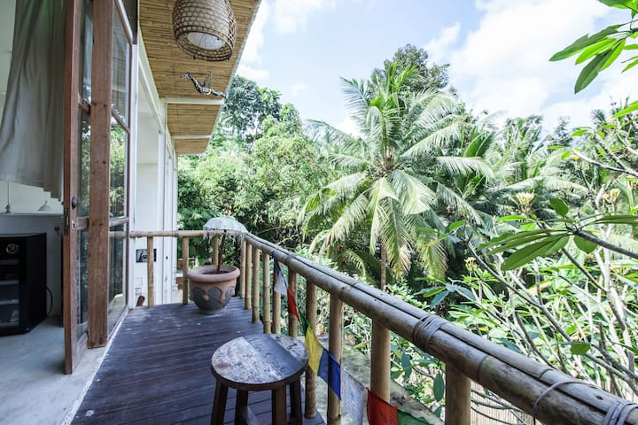 Enjoy the view above palm trees from your private balcony!