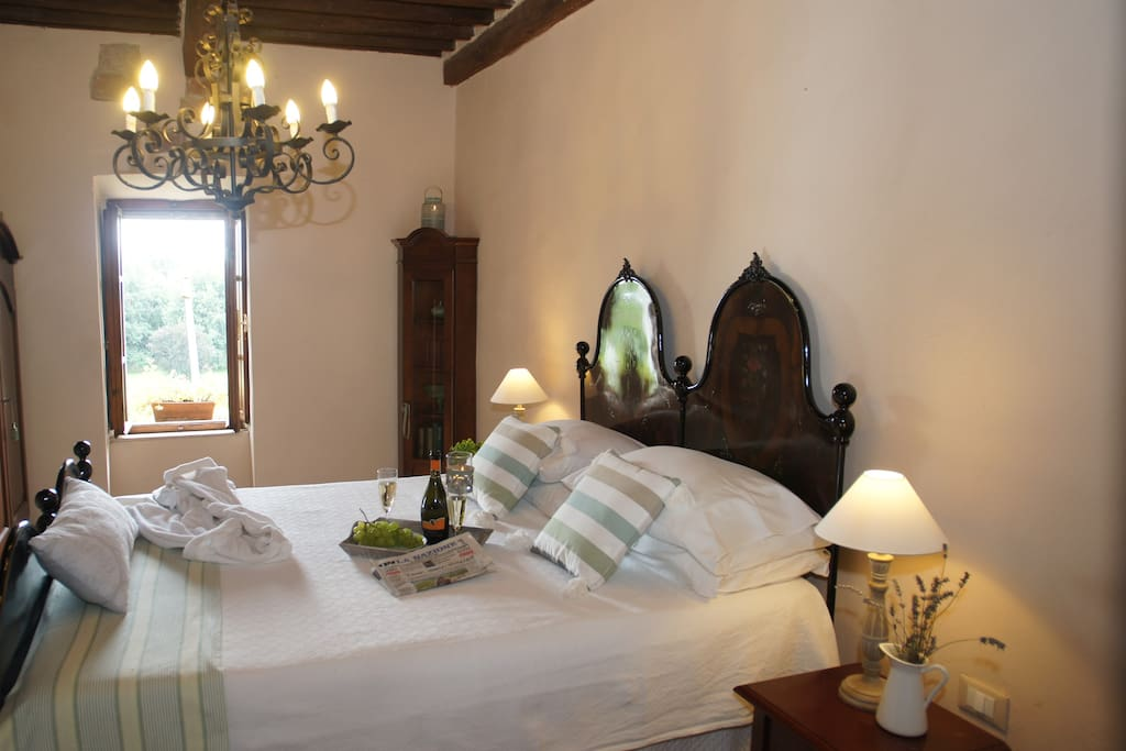 The romantic bedroom in the tower has a traditional Tuscan furnishings