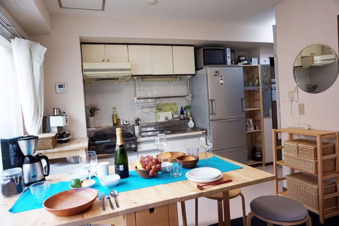 The kitchen and dining area is great for a drink or even a full course meal with friends. Our large fridge can handle it.