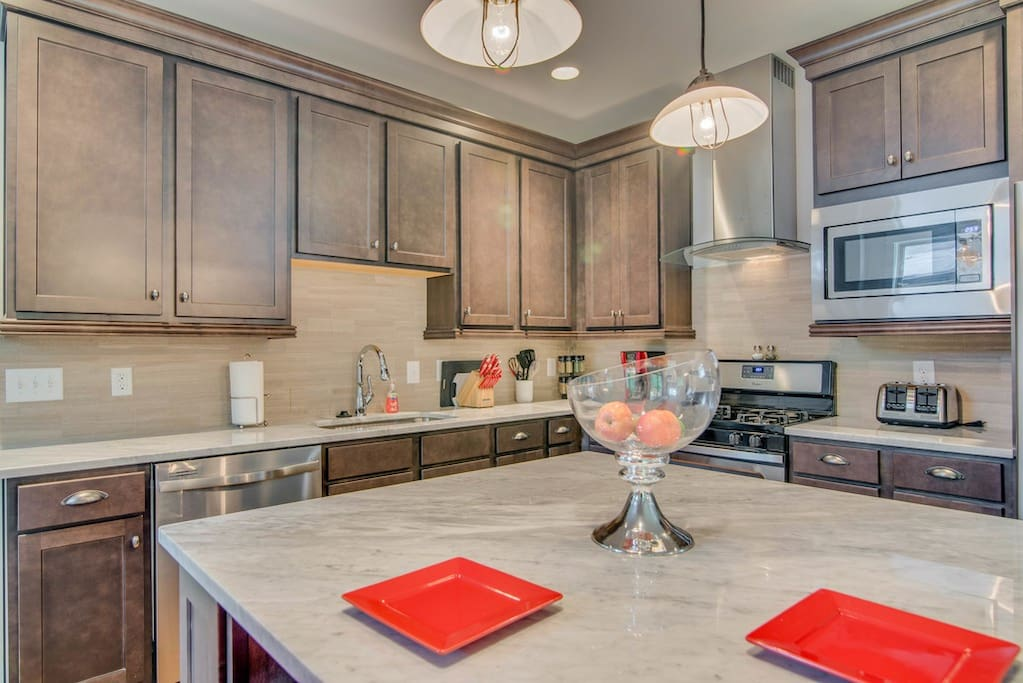 Marble counter-tops and beautiful cabinets make this kitchen great.