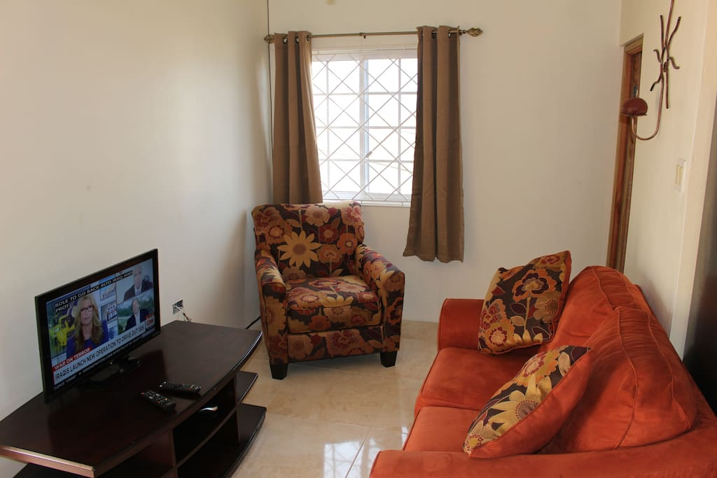 Living room equipped with LCD TV with cable channels. WiFi Internet is also free.