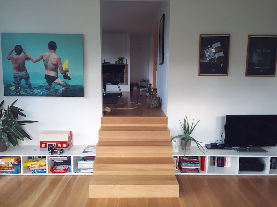 This used to be an indoor swimming pool. Now the stairs lead down to a bright and spacious living room.
