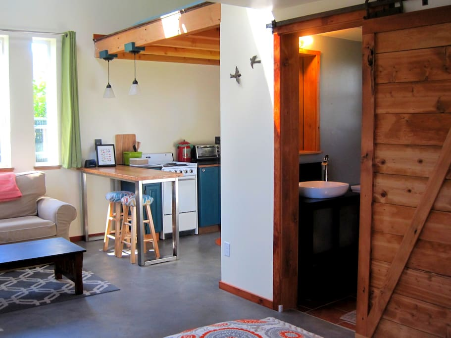 Kitchen + bath entrance with handmade sliding barn door