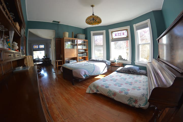 Room three, with the two extra futons placed in the dining room to make 5 queen/double beds for a possible 10 person occupancy. French doors were just added for extra privacy.