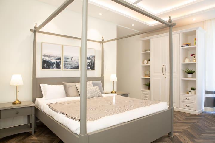 Coastal Theme Master Bedroom with Ensuite Bathroom & Balcony   Villa La Dolce Vita   Private Infinity Pool   Terrace Deck   Field Views   Fully Serviced