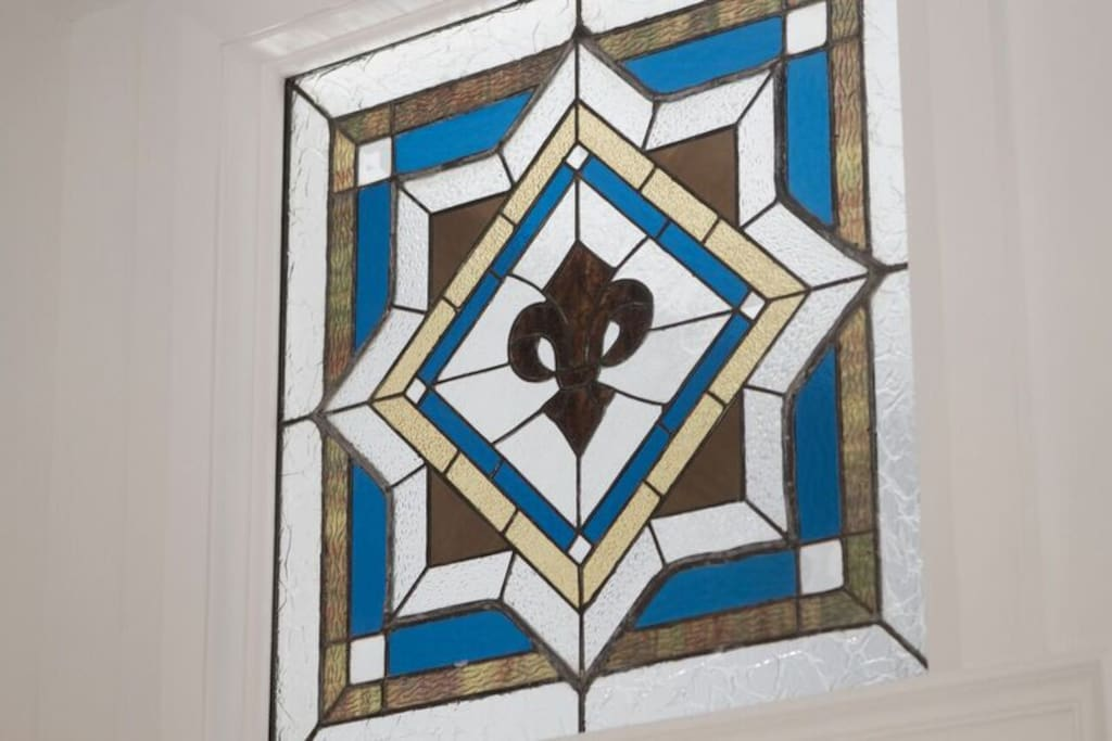 Period details like one-of-a-kind stained glass windows.
