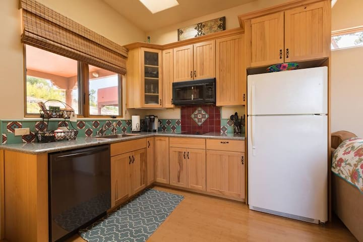 Plenty of granite counter space in kitchen with full-size fridge, dishwasher, stove-top, microwave/convection oven