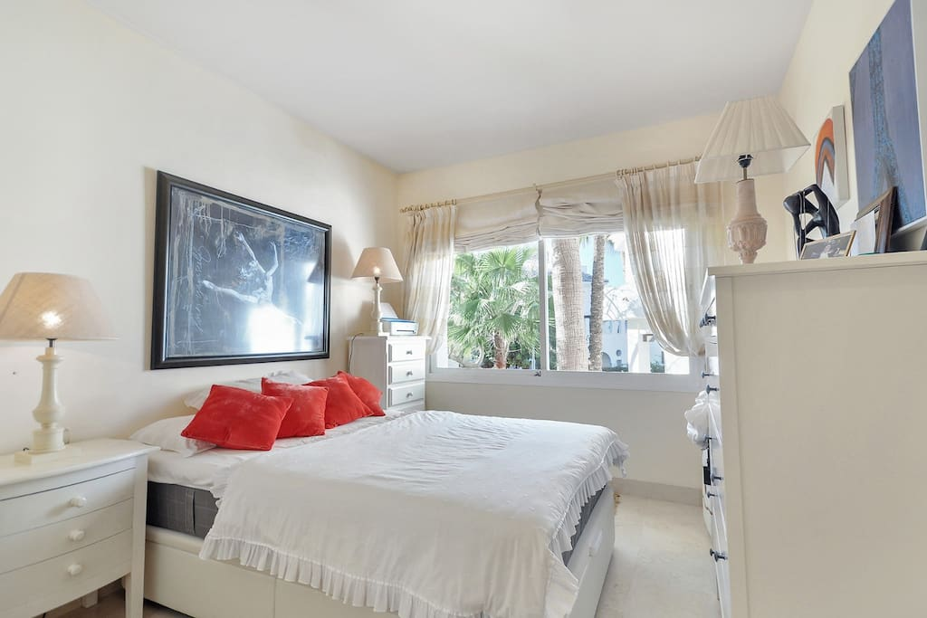 Guest room , with all the facilities wardrobe and windows view for garden and street