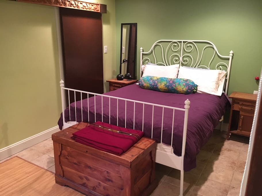 Master bedroom with comfy queen bed, big closet, attached bathroom and desk